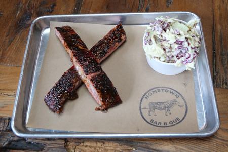 BROOKLYN, NEW YORK - MAY 25, 2017: Short rib BBQ and coleslow salad served in Hometown Bar B Que restaurant in Brooklyn, New York
