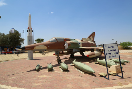 HATZERIM, ISRAEL - MAY 2, 2017: The Israel Aircraft Industries Kfir with its typical weapon loadout on display at the Israeli Air Force Museum. Редакционное