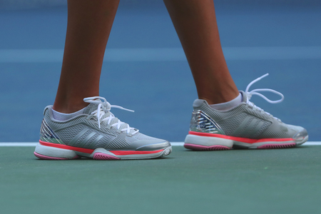 NEW YORK - AUGUST 30, 2016: Professional tennis player Kateryna Kozlova of Ukraine wears custom Adidas by Stella McCartney tennis shoes during match at US Open 2016 Editorial