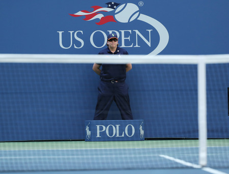 racket stadium: NEW YORK - AUGUST 30, 2016: Line judge during match at US Open 2016 at Billie Jean King National Tennis Center in New York
