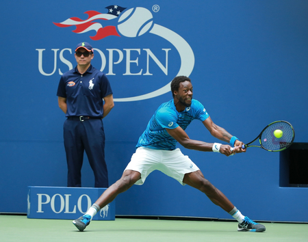 NEW YORK - SEPTEMBER 6, 2016: Professional tennis player Gael Monfis of France in action during his US Open 2016 quarterfinal match at National Tennis Center Editorial