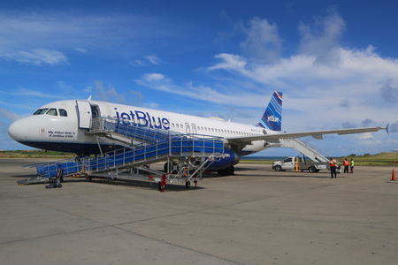 jetblue: TRUE BLUE, GRENADA - JUNE 13, 2017: JetBlue Embraer 190 plane on tarmac at Maurice Bishop International Airport in Grenada