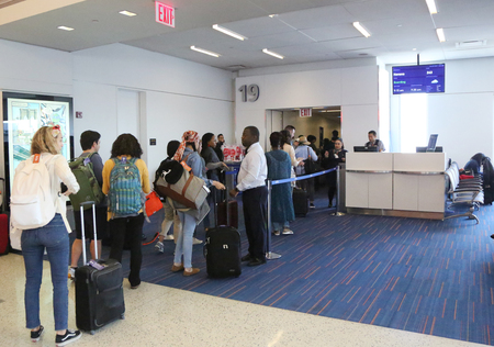 jetblue: NEW YORK- JUNE 9, 2017: Passengers boarding JetBlue flight to Havana, Cuba at JetBlue Terminal 5 at John F Kennedy International Airport in New York