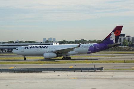 NEW YORK- JUNE 9, 2017: Hawaiian Airlines jet on tarmac at John F Kennedy International Airport in New York Editorial
