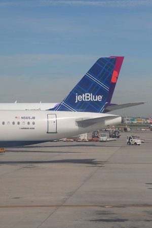 NEW YORK - JUNE 9, 2017: JetBlue plane on tarmac at John F Kennedy International Airport in New York