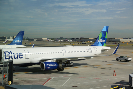 jetblue: NEW YORK - JUNE 9, 2017: JetBlue plane on tarmac at John F Kennedy International Airport in New York