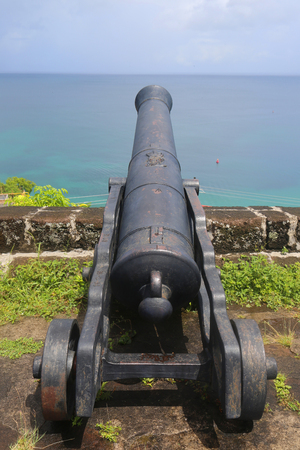 grenada: ST. GEORGES, GRENADA - JUNE 12, 2017: Old cannons at historical Fort George in St. Georges, Grenada. Built in 1705 by the French, many of the buildings are now used by the police
