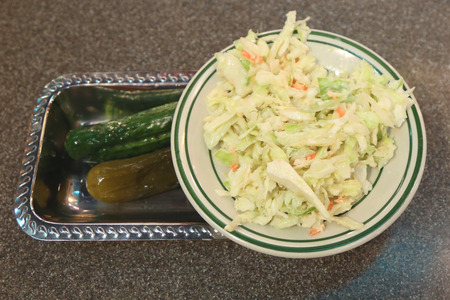 bens: Cole slaw and pickles appetizer served in New York Deli
