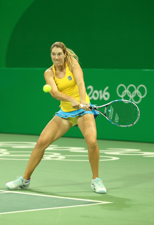 RIO DE JANEIRO, BRAZIL - AUGUST 7, 2016: Professional tennis player Olga Savchuk of Ukraine in action during doubles first round match of the Rio 2016 Olympics at the Olympic Tennis Centre Editorial