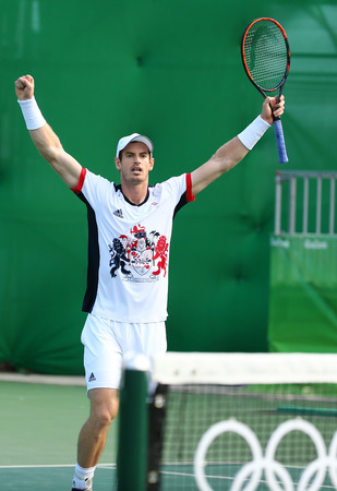 olympic ring: RIO DE JANEIRO, BRAZIL - AUGUST 12, 2016: Olympic champion Andy Murray of Great Britain celebrates victory after mens singles quarterfinal of the Rio 2016 Olympic Games at the Olympic Tennis Centre