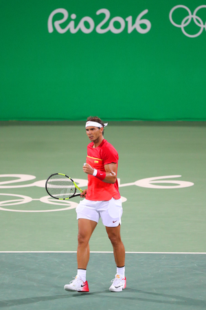 RIO DE JANEIRO, BRAZIL - AUGUST 9, 2016: Olympic champion Rafael Nadal of Spain in action during mens doubles round 3 of the Rio 2016 Olympic Games at the Olympic Tennis Centre Editorial