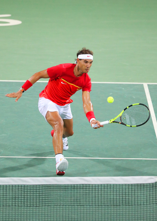 janeiro: RIO DE JANEIRO, BRAZIL - AUGUST 9, 2016: Olympic champion Rafael Nadal of Spain in action during mens doubles round 3 of the Rio 2016 Olympic Games at the Olympic Tennis Centre Editorial