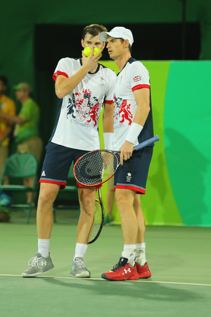 RIO DE JANEIRO, BRAZIL - AUGUST 7, 2016: Tennis players Andy Murray (R) and Jamie Murray of Great Britain in action during mens doubles first round match of the Rio 2016 Olympic Games