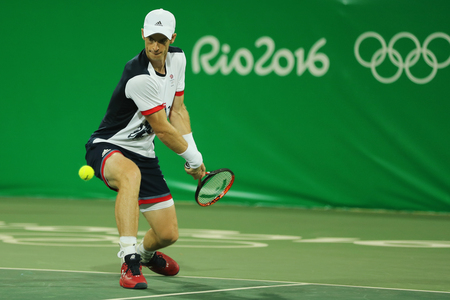 olympic ring: RIO DE JANEIRO, BRAZIL - AUGUST 7, 2016: Olympic champion Andy Murray of Great Britain in action during mens doubles first round match of the Rio 2016 Olympic Games at the Olympic Tennis Centre Editorial