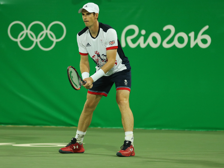 RIO DE JANEIRO, BRAZIL - AUGUST 7, 2016: Olympic champion Andy Murray of Great Britain in action during mens doubles first round match of the Rio 2016 Olympic Games at the Olympic Tennis Centre Editorial