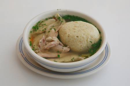 Matzah ball soup served in New York Deli Stock Photo
