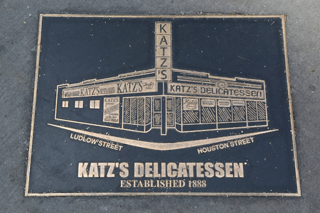 NEW YORK - JUNE 27, 2017: Bronze plaque in front of the historical Katzs Delicatessen (est. 1888), a famous restaurant, known for its Pastrami sandwiches in Lower East Side in Manhattan