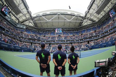 milánó: NEW YORK - SEPTEMBER 6, 2016: Ball boys on Arthur Ashe Stadium during US Open 2016 at the Billie Jean King National Tennis Center in New York Sajtókép