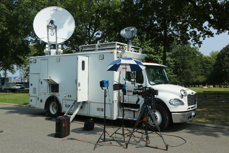 NEW YORK - SEPTEMBER 10, 2016: CNN truck in the front of National Tennis Center. CNN was the first channel to provide 24-hour television news coverage.