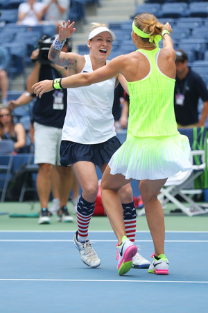 racket stadium: NEW YORK - SEPTEMBER 11, 2016: US Open 2016 women doubles champions Lucie Safarova (R) of Czech Republic and Bethanie Mattek-Sands of United States celebrates victory after final match in New York Editorial