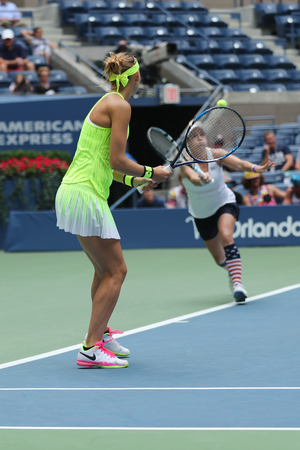 NEW YORK - SEPTEMBER 11, 2016: US Open 2016 women doubles champions Lucie Safarova (L) of Czech Republic and Bethanie Mattek-Sands of United States in action during final match in New York