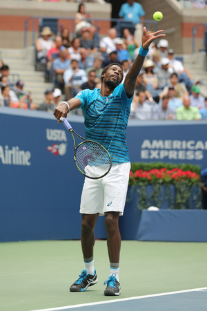 racket stadium: NEW YORK - SEPTEMBER 6, 2016: Professional tennis player Gael Monfis of France celebrates victory after his US Open 2016 quarterfinal match at National Tennis Center