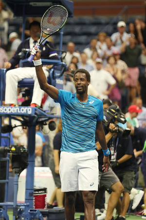 NEW YORK - SEPTEMBER 6, 2016: Professional tennis player Gael Monfis of France celebrates victory after his US Open 2016 quarterfinal match at National Tennis Center