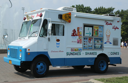 NEW YORK - SEPTEMBER 10, 2016: Ice cream truck in Flushing Meadows Park. Mister Softee is a United States-based ice cream truck franchisor popular in the Northeast founded in 1956
