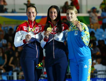 RIO DE JANEIRO, BRAZIL - AUGUST 8, 2016:Womens Sabre Individual winners at Rio 2016 Olympic Games Sofya Velikaya of Russia (L),Yana Egorian of Russia and Olga Kharlan of Ukraine during medal ceremony