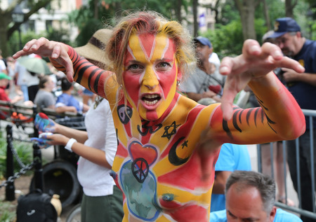 NEW YORK - JULY 22, 2017: Artists paint 100 fully nude models of all shapes and sizes during 4th NYC Body Painting Day featuring artist Andy Golub on Washington Square in New York Editöryel