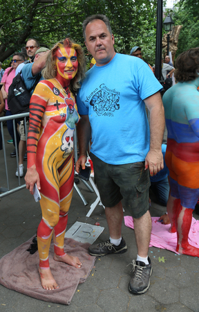 NEW YORK - JULY 22, 2017: Artists paint 100 fully models of all shapes and sizes during 4th NYC Body Painting Day featuring artist Andy Golub on Washington Square in New York