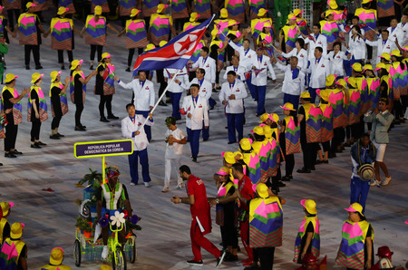 marched: RIO DE JANEIRO, BRAZIL - AUGUST 5, 2016: Olympic team the Democratic Peoples Republic of Korea marched into the Rio 2016 Olympics opening ceremony at Maracana Stadium in Rio de Janeiro