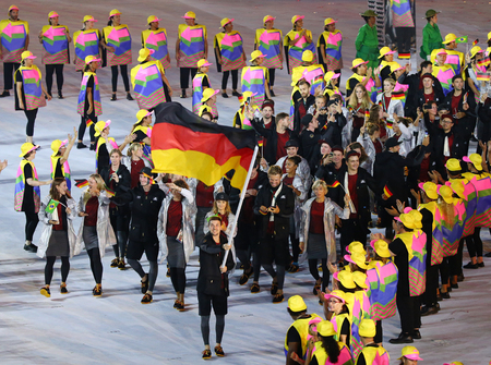 marched: RIO DE JANEIRO, BRAZIL - AUGUST 5, 2016: Olympic team Germany marched into the Rio 2016 Olympics opening ceremony at Maracana Stadium in Rio de Janeiro Editorial