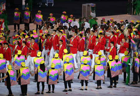 marched: RIO DE JANEIRO, BRAZIL - AUGUST 5, 2016: Olympic team The Peoples Republic of China marched into the Rio 2016 Olympics opening ceremony at Maracana Stadium in Rio de Janeiro