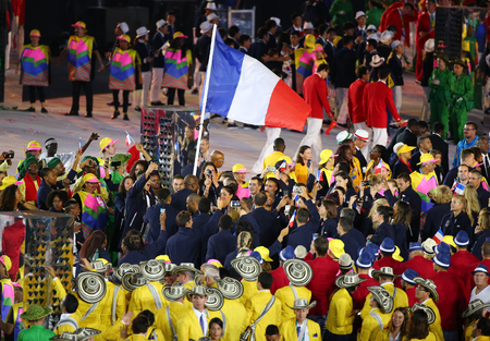 marched: RIO DE JANEIRO, BRAZIL - AUGUST 5, 2016: Olympic team France marched into the Rio 2016 Olympics opening ceremony at Maracana Stadium in Rio de Janeiro Editorial
