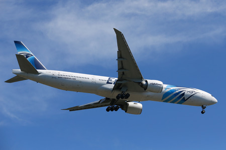 NEW YORK - JULY 18, 2017: EgyptAir Boeing 777 descends for landing at JFK International Airport in New York