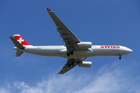 NEW YORK - JULY 18, 2017: Swiss International Airlines Airbus A330 descending for landing at JFK International Airport in New York Editorial