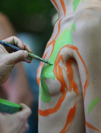 NEW YORK - JULY 22, 2017: Artists paint 100 fully nude models of all shapes and sizes during 4th NYC Body Painting Day featuring artist Andy Golub on Washington Square in New York Editorial