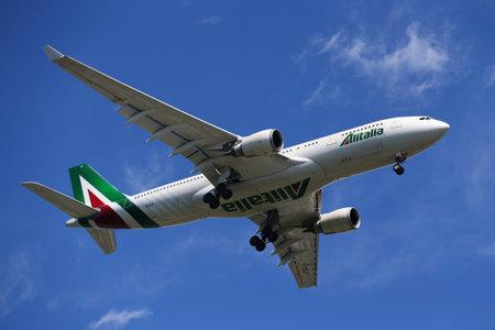 NEW YORK - JULY 18, 2017: AlItalia Airbus A330 descending for landing at JFK International Airport in New York Editorial