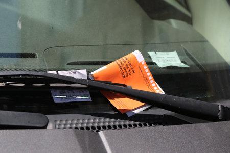NEW YORK - JUNE 26, 2017: Illegal Parking Violation Citation On Car Windshield in New York