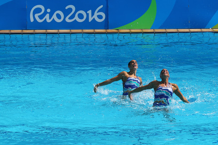 RIO DE JANEIRO, BRAZIL - AUGUST 15, 2016: Ona Carbonell and Gemma Mengual of Spain compete during the synchronized swimming duet technical routine preliminary round at the 2016 Summer Olympics