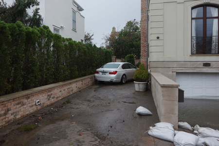FAR ROCKAWAY, NEW YORK  - OCTOBER 30, 2012: Water damaged car and flooded garage in the aftermath of Hurricane Sandy in Far Rockaway, New York