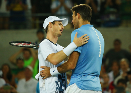 the olympic rings: RIO DE JANEIRO, BRAZIL - AUGUST 14, 2016: Juan Martin Del Potro (R) congratulates Olympic champion Andy Murray of Great Britain with his victory at mens singles final of the Rio 2016 Olympic Games