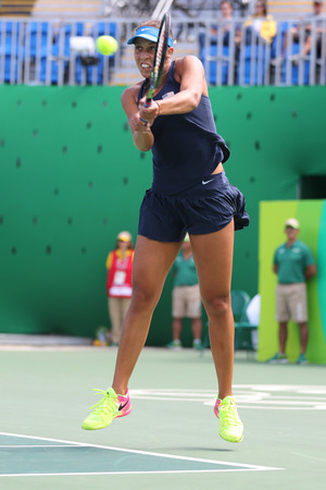 RIO DE JANEIRO, BRAZIL - AUGUST 11, 2016: Professional tennis player Madison Keys of United States in action during her quarter final match of the Rio 2016 Olympic Games at the Olympic Tennis Centre Editorial