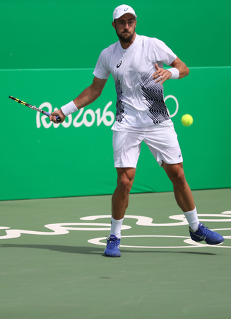 RIO DE JANEIRO, BRAZIL - AUGUST 11, 2016: Professional tennis player Steve Johnson  of United States in action during his round 3 match of the Rio 2016 Olympic Games at the Olympic Tennis Centre Editorial