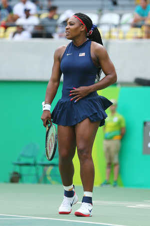 the olympic rings: RIO DE JANEIRO, BRAZIL - AUGUST 7, 2016: Olympic champion Serena Williams of United States in action during singles first round match of the Rio 2016 Olympic Games at the Olympic Tennis Centre Editorial