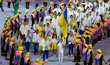 marched: RIO DE JANEIRO, BRAZIL - AUGUST 5, 2016: Ukrainian Olympic team marched into the Rio 2016 Olympics opening ceremony at Maracana Stadium in Rio de Janeiro