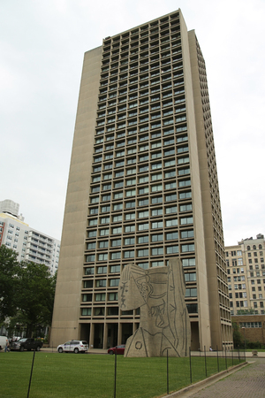 NEW YORK - JUNE 16, 2016:The NYU Silver Towers and cubistic sculpture known as the Bust of Sylvette created by the Norwegian artist Carl Nesjar in 1968 and was done in collaboration with Pablo Picasso