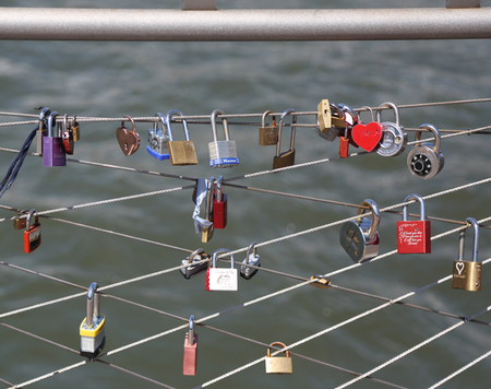 BROOKLYN, NEW YORK - AUGUST 13, 2017: Love locks at the Brooklyn Bridge Park in Brooklyn, New York. Ritual of affixing padlocks, as symbol of love, to bridge is spread in Europe from 2000s
