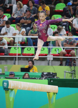 RIO DE JANEIRO, BRAZIL - AUGUST 9, 2016: Fan Yilin of China competes during a balance beam event of womens team final of Artistic Gymnastics at the 2016 Rio Olympic Games in Rio de Janeiro, Brazil